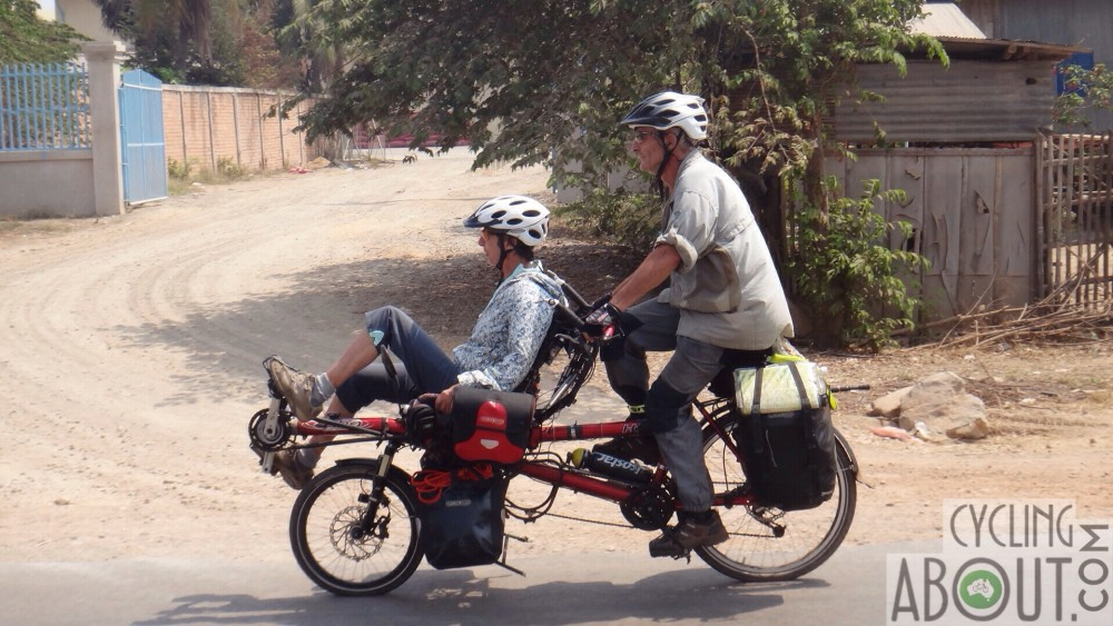 Sylvie and Hubert cycling with me in Cambodia.