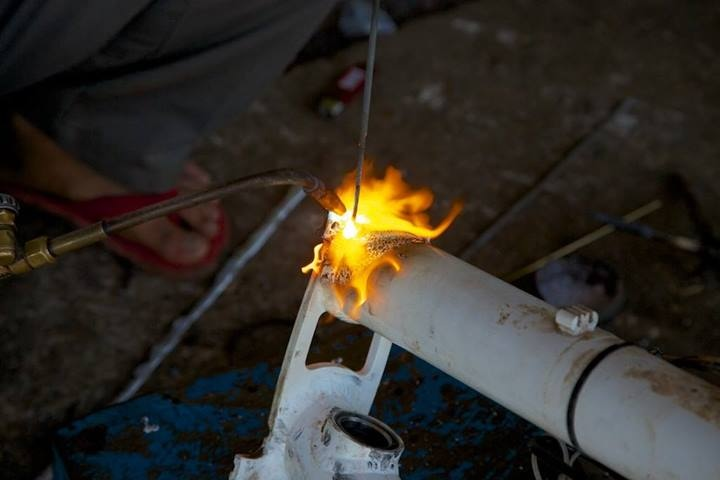 Marcel and Alena's Pino frame getting a new weld in Cambodia.