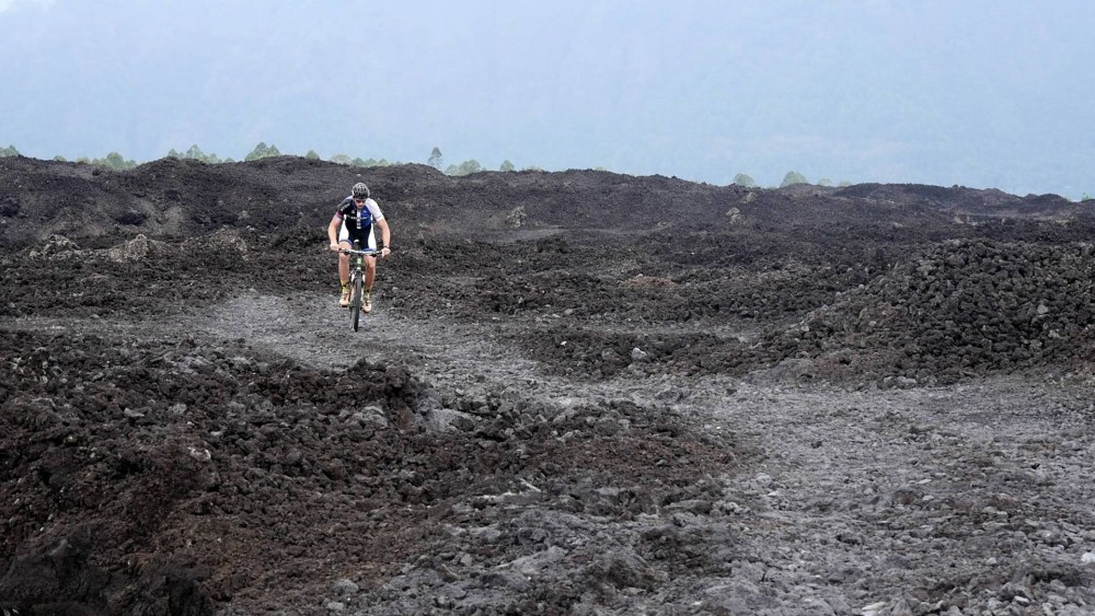 Cycling on the volcanic rocks of Mt Batur.