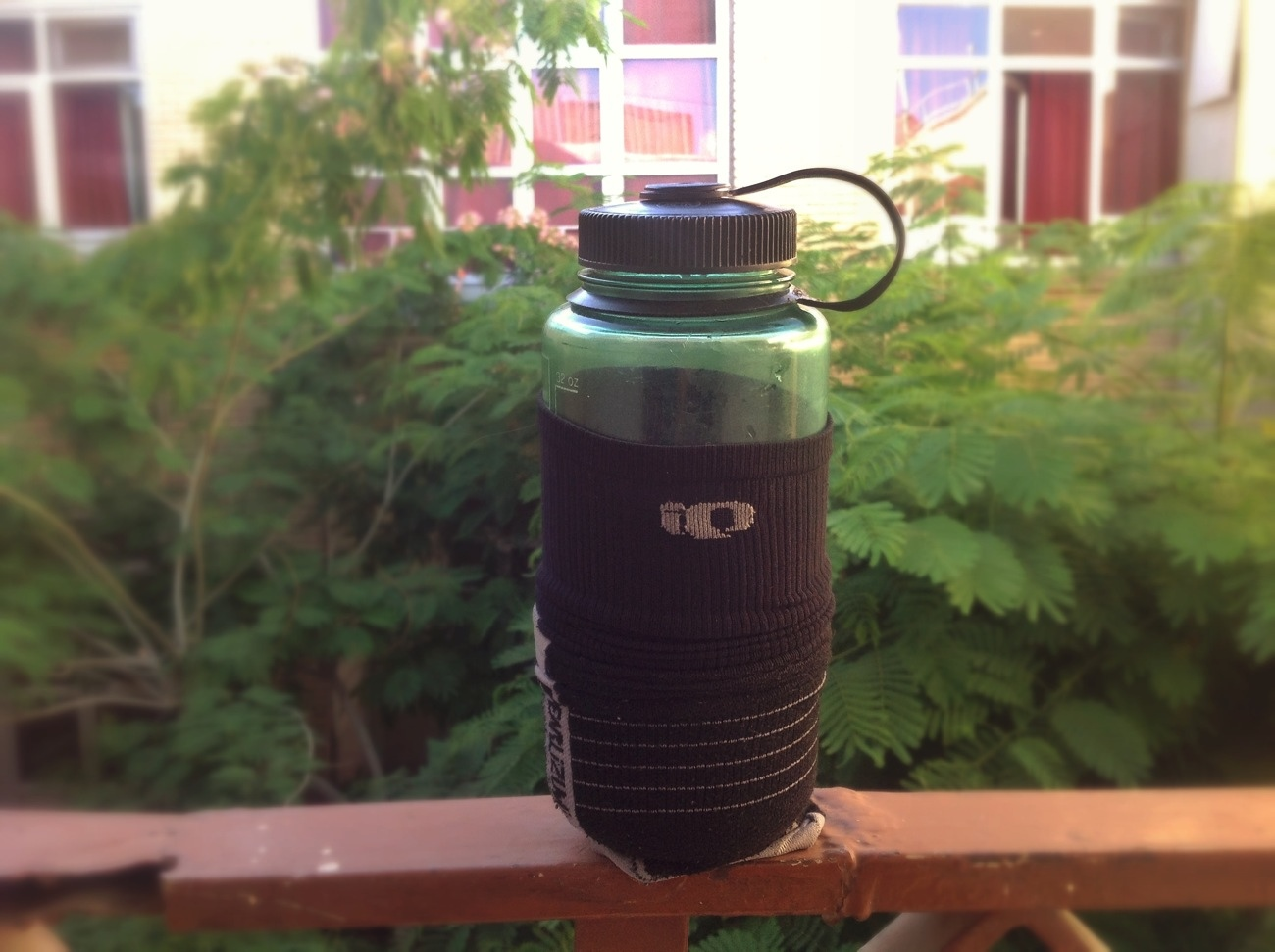 Make a homemade hot water bottle with a plastic Nalgene bottle and a sock